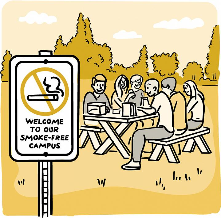 "Cartoon of a ""No-Smoking"" sign in an open outdoor area, with nearby people enjoying a picnic lunch."