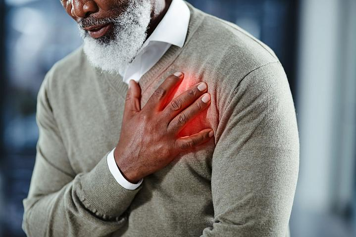 Man with his hand over his heart in pain