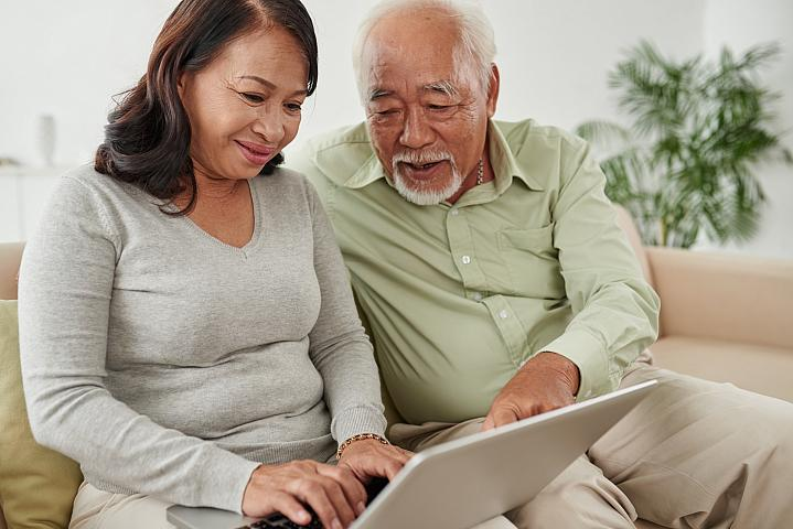 Older couple looking up health information on a laptop