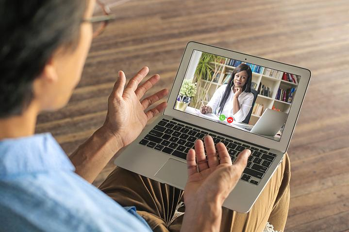 Man talking with his mental health provider over video chat